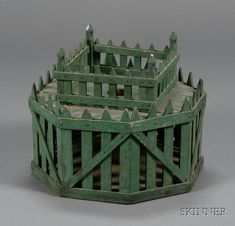 "Late 19th century American feather tree stand; painted pine hexagonal and square two-tier picket fence style stand, 10.5""H x 12.5""D . http://direct.skinnerinc.com/auctions/2431/lots/759"