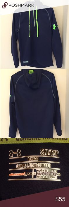 Men's Under Armour Jacket This Under Armour half zip hoody is in perfect condition (except, my last name is written on the tag). It is a high quality jacket that can double as workout gear or street wear. It is made out of a thick polyester material with neon green detailing. This navy jacket is true to size (adult small). This jacket has only been worn 2 times and looks brand new. Under Armour Jackets & Coats