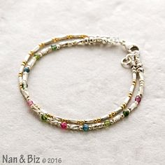 This delicate, two-strand tourmaline bracelet is made of modern, handmade Thai…