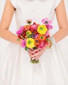 colorful wedding bouquet with fabulous ranunculas and anemones