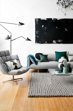 modern living room with light grey upholstery and a couple of green accents