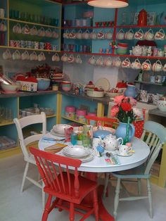 cute table with different coloured chairs