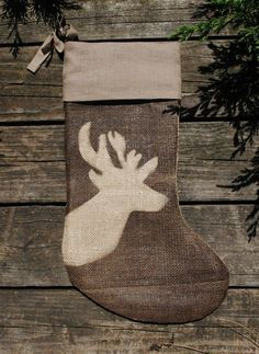 stocking... Stenciled with fabric paint.  I have a new obsession with deer heads, good thing Andre likes it lol
