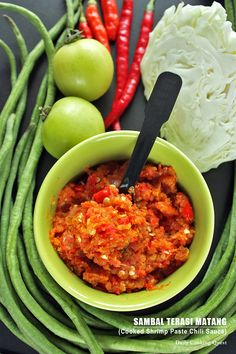 There are so many varieties of sambal (chili sauce) in Indonesia. Every region has at least one specialty and everyone's Mom seems to have a killer sambal recipe. If someone is to pick up the herculean task of gathering and documenting the various sambal Spicy Recipes, Asian Recipes, Cooking Recipes, Ethnic Recipes, Seafood Recipes, Dinner Recipes, Chutneys, Sambal Recipe, Sambal Sauce