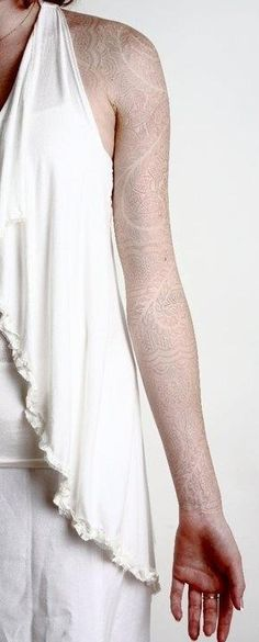 Beautiful white / grey sleeve tattoo. So subtle... too bad it wouldn't have the same effect since my other arm is bright