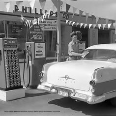 Phillips 66, Minnesota Historical Society, Fuel Truck, Vintage Gas Pumps, Gas Service, Old Garage, Old Gas Stations, Filling Station, Cadillac Fleetwood