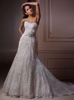 Embrace - by Maggie Sottero, in stock, sample size 14. Bridal Boutique, St. Joseph, Missouri