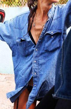 Grab an oversized denim shirt as a beach cover-up