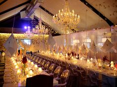 long tables, chandeliers, hanging napkins