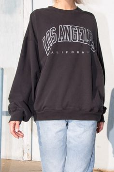 Soft oversized cotton pullover sweatshirt in black with a crewneck front, relaxed fit and the Los Angeles California graphic printed on the chest. Sweatshirt Outfit, Sweater Outfits, Crew Neck Sweatshirt, Girl Outfits, Cute Outfits, Fashion Outfits, Teenager Outfits, School Outfits, Aesthetic Fashion