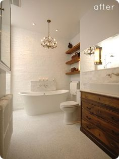 I want to recreate this feel. All white with the wood vanity, floating wood shelves, and white sink.