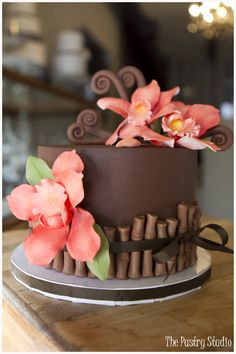 A Tropical Chocolate Decadent Cake with Coral Sugar-Paste Orchids  Bamboo by The Pastry Studio: Daytona Beach, Fl