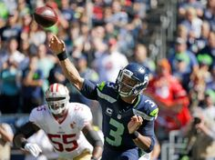 Seattle Seahawks quarterback Russell Wilson throws against the San Francisco 49ers in the first half of an NFL football game, Sunday, Sept. 25, 2016, in Seattle.