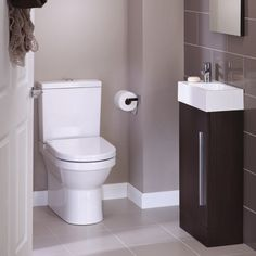 Cloakroom - very similar to mine except mine is all white. I love this colour scheme. (give me more space in my bathroom ) Cloakroom Toilet Downstairs Loo, Cloakroom Sink, Small Bathroom Sinks, Small Sink, Bathroom Layout, Cloakroom Ideas, Bathrooms, Bathroom Ideas, Clockroom Toilet