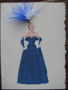 This 1953 Hardy Amies Blue silk Evening Gown with a fitted bodice and full skirt of tiny pleats worn with a full length stole fashion print is mounted on 5x7 high quality card stock and embellished with glitter, feathers, and rhinestones. Includes envelope. Blank inside. Suitable for framing.I cant help it.Im immensely impressed by all genuine upper-class manifestations.  -Hardy Amies- Was famous for being the Queens official dressmaker in 1955. He would later design for Princess Diana.
