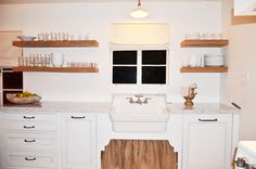 Reclaimed Wood Shelves, Subway Tile, and Farm Sink in Cottage Kitchen.  Design by Michelle D. Young