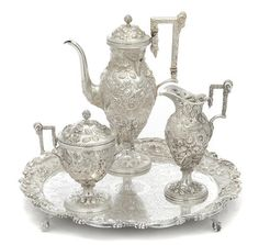 An American  sterling silver  floral and foliate repousse-decorated three-piece coffee service with matching footed waiter by S. Kirk & Son Co., Baltimore, MD, circa 1896-1925. AUCTION 22389: FINE FURNITURE, SILVER, DECORATIVE ARTS & CLOCKS 4 Mar 2015 10:00 EST  NEW YORK