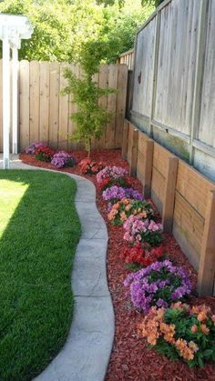 I like the way this looks- neat and colorful! Would use dark or natural mulch OR Mexican beach pebbles/river rock.