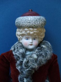Beautiful Bisque Bonnet Head Doll by Hertwig. UFDC.ORG magazine, the Butler Brothers catalog of 1898 shows a line of International Bonnet Head Dolls introduced by Hertwig ~ See photos ~ This is the red hat version Russia doll head.