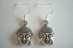 BNWOT  Silver Tone Alloy Buddha Face Dangle Drop Earrings found at outofthefireuk on ebay.co.uk