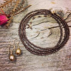 Copper hematite wrap bracelet and 18k champagne pearl and diamond earrings available at @magpiejewellery Westboro. #preciouseveryday #annesportun #shopottawa