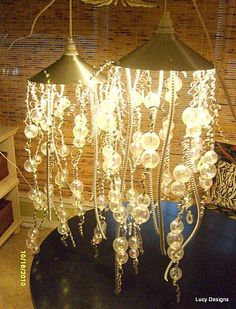 """jellyfish"" pendant lights from recycled conduit, ornaments, wire, etc #lighting #DIY #pendant"