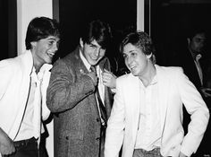 American actors Rob Lowe, Tom Cruise, and Emilio Estevez at the premiere screening of the TV movie, 'In The Custody of Strangers,' directed by Robert Greenwald, Beverly Hills, California, April 22, 1982. Lowe and Estevez both wear white jackets with open-neck shirts and Cruise wears a darker jacket; Lowe and Cruise also wear ties and have upturned collars on their jackets. (Photo by Frank Edwards/Fotos International/Getty Images)