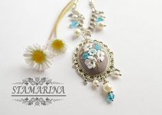 This floral necklace is carefully handcrafted from polymer clay by using embroidery or applique technique. Delicate floral pattern is attached to the