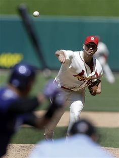 starting pitcher Adam Wainwright throws during the sixth inning.  Waino went the distance with a 2hit complete game shutout against the Rockies.  Cards won 3-0.  5-11-13