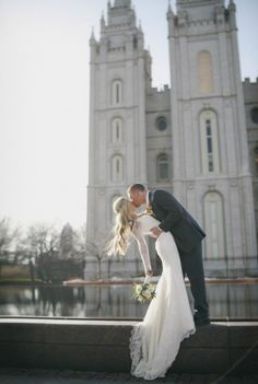 Amazing bride in a beautiful wedding dress. Love this kiss photo!