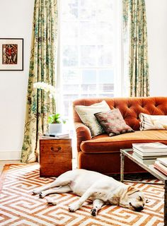 Tour the Most Elegant Townhouse You May Ever See via @domainehome. Love the deep tufting on that sofa!