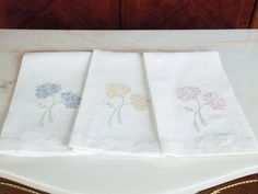Hydrangea Blossoms - Luxury Bath Linen Sweet hydrangea blossoms, ubiquitous among the most charming New England coastal homes, are beautifully hand embroidered with the tiniest of stitches on 100% pure White Italian linen. The hem on this import is finished with elegantly curved shadow stitching and the remaining borders tailored with delicate hemstitching, done by hand. Every aspect of these delightful guest towels boasts attention to detail.
