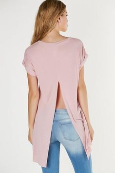 Crew neck oversized T-shirt with hi-low hem. Soft blend of materials with slit in center back.  Modal-Polyester blend Made in USA Model is wearing size S Runs true to size Hand wash cold Available in Beige & Pink