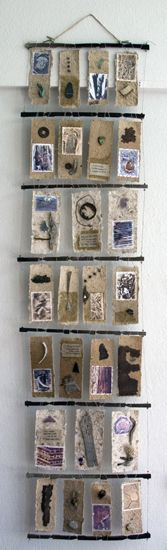 "Tracks Along the Arkansas by Mary-Ellen Campbell - Books from Natural Materials | mixed media 84x24x2"" #hanging #book_arts"