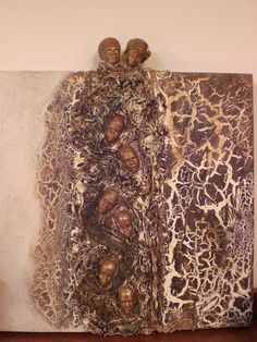 Canvas made with Powertex  and Bister, cotton and African heads.   SOLD