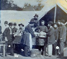 Dr. Martyn Fonds attending surgery at Gettysburg, Pa., during the Civil War.  The Union surgeon above is applying a bandage to a shoulder resection as the ether mask is being removed by the assistant.  A rare view of an actual surgery during the War
