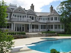 shingle-style home is lucky enough to have a widow's walk. Some of its shingle characteristics include a turret, prominent chimneys, irregular roof lines and a stone foundation