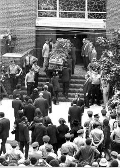 Casket of Louis Armstrong is borne into Corona Congregational Church for funeral services.