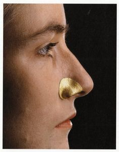 """Nostril - for Barbara Seidenaht´s Nose - by Gerd Rothman Gold 1985 """"An unconventional dialogue with the human body"""" Since he began designing jewelry over 40 years ago, goldsmith Gerd Rothman has incorporated cast part of the human body into his practice. His tactile pieces are custom-made and individualised to an hyper-specific part of his client´s body."""