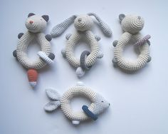 RABBIT rattle crocheted, handmade in 100 % cotton and stuffed with fiber. The perfect gift for a babyshower celebration. A rattle is a great way to engage a babys developing sight and sound skills. There is a little bell inside that gives a subtle sound when the baby moves the rattle, making it a lovely first toy. Also, it can be use as a teething toy. All differents parts of the rattle are perfectly secured and the nose and eyes are embroidered to make it safer for your baby. Approximate…