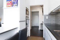 37m² con cama escondida bajo una elevación en el salón