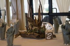 Here is an example of the  unique driftwood centerpieces that Matt and Katie Strand created out of driftwood.  They even used a branding iron to inscribe their initials.  I accented them with  flowers and succulents.The flowers included larkspur, eucalyptus, waxflower, eryngium and several types of succulents. Driftwood Wedding Centerpieces, Types Of Succulents, Branding Iron, Initials, Unique, Flowers, Royal Icing Flowers, Flower, Florals