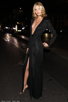 Stunning:The Swedish bombshell, 28, looked sensational in the shimmering black gown, which had a thigh-skimming leg slit to show off her enviably toned pins