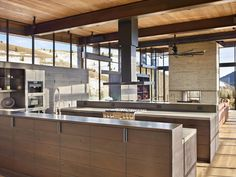 Architecture firm Olson Kundig have designed this modern industrial house in the mountains of Idaho, that has a pivoting glass wall. Concrete Bath, Concrete Counter, Board Formed Concrete, Modern Mountain Home, Kitchen Stove, Kitchen Island, Modern Farmhouse Plans, Architect House, Industrial House