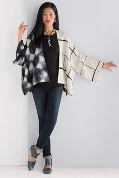 Luna Jacket by Laura Hunter. An exquisite work of art to wear, this jacket is hand dyed using traditional Japanese itajime shibori techniques. The artist carefully folds and binds the fabric before dyeing to create bold patterns that alternate with panels of solid black.