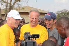 "Hollywood greats, Producer Frank Marshall, Gary Cohen and Mike Tollin on location in Uganda while filming the ESPN documentary ""Right To Play."""