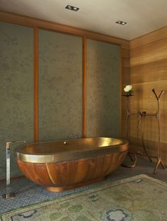"""(Laura Ziskin's Home) A teak and hammered-bronze tub from India is joined by teak-framed de Gournay panels, a C.F.A. Voysey rug and Michael Wilson's """"silent valet."""""""