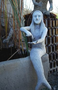 At the Owl House in Nieu Bethesda there's at least fourteen cement statues of mermaids. Cement Statues, Provinces Of South Africa, Tomorrow Is Another Day, Move Mountains, Owl House, My Land, Outsider Art, Africa Travel, Garden Art