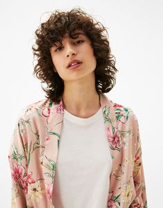 Long dressing gown with floral print. Discover this and many more items in Bershka with new products every week