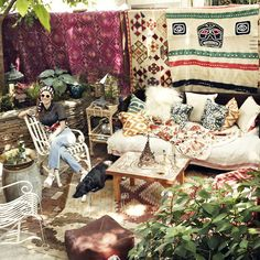love this cozy patio + rugs + couch + ikat